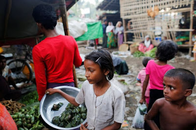 A Rohingya girl selling food at the internally displaced persons camp for Rohingya people outside Sittwe in the state of Rakhine, Myanmar. — (Photo: Reuters)